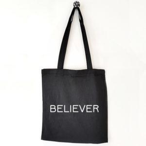 Katoenen tas met tekst Believer