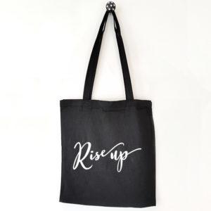 Katoenen tas met tekst Rise up