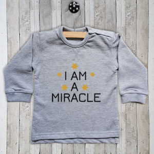 Sweater met tekst I am a miracle